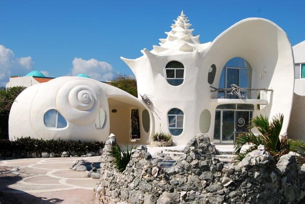 unique white house in shape of chonch shell