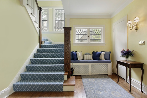 Entry area of luxury home with yellow walls