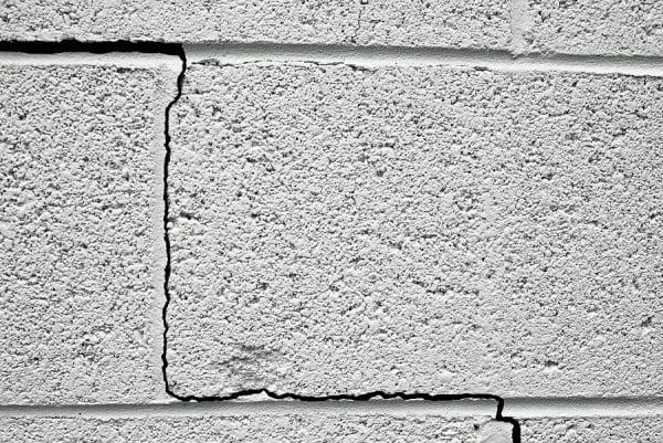 a crack in a concrete building foundation