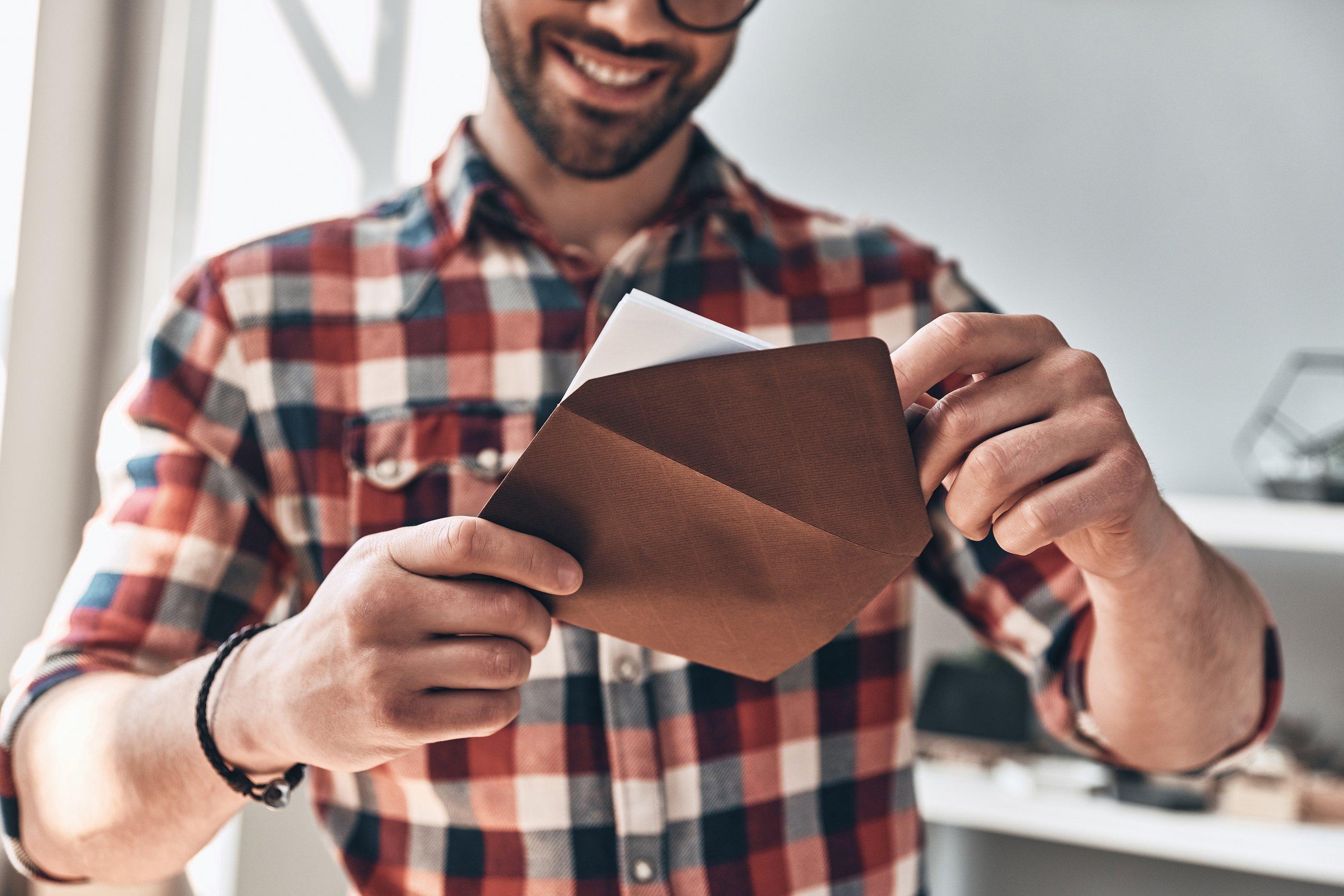 bigstock-Receiving-Greeting-Card-Close-239099077